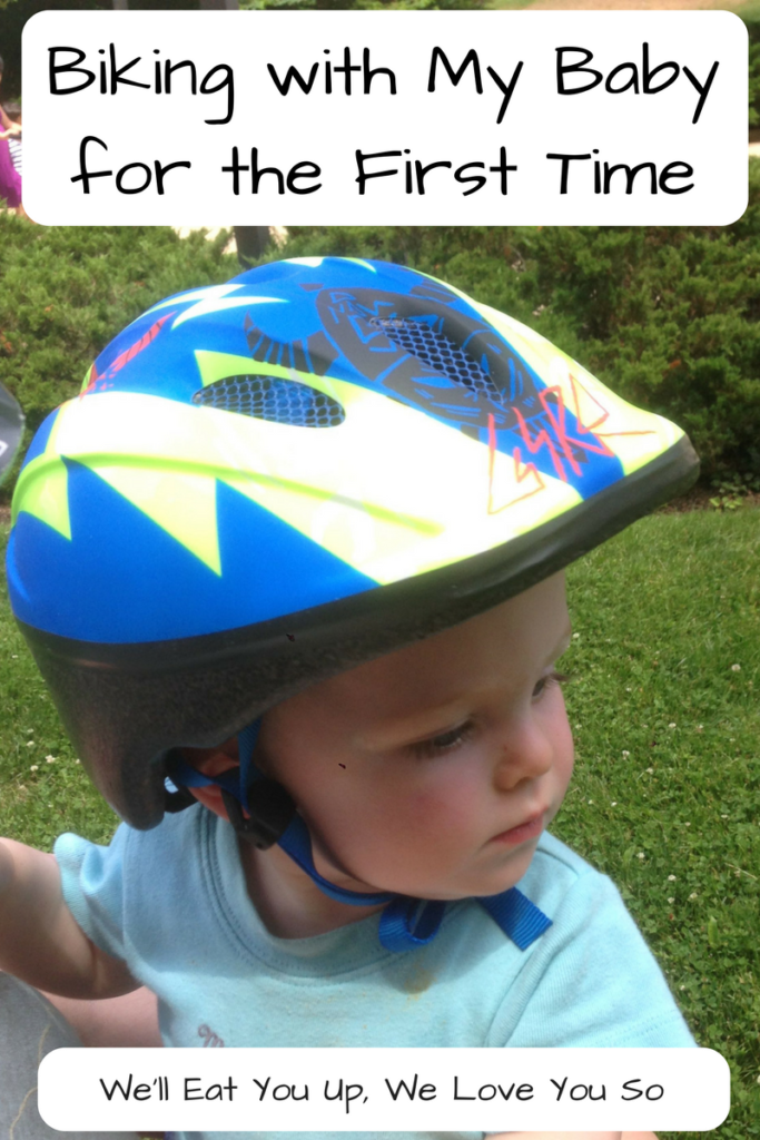 Biking with a Baby for The First Time - Thinking about bringing your baby on a bike via a trailer? This is what happened on my first ride with my almost one-year-old. (Photo: Baby in a bike helmet)