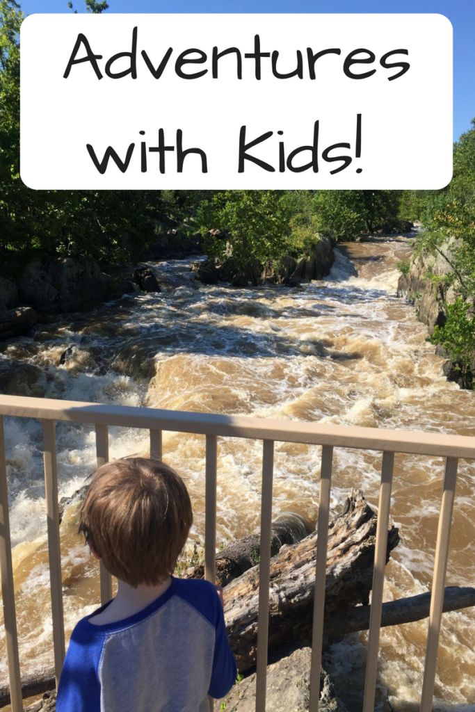Adventures With Kids - Yes, you can go on adventures with kids. Here's some ways how to. Photo: Child looking out on a waterfall.