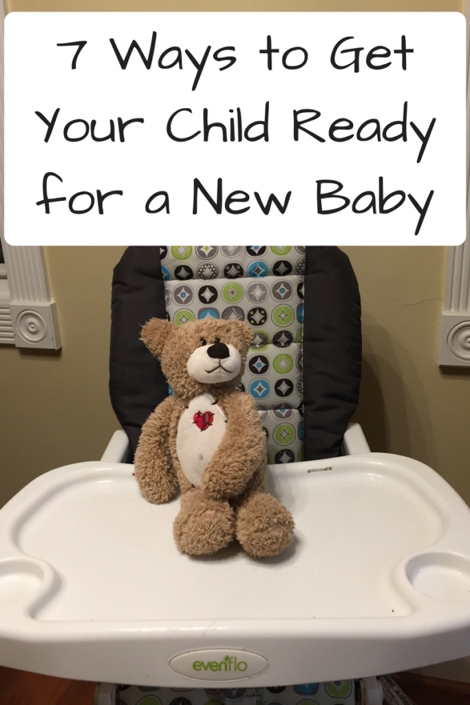 7 Ways to Get Your Child Ready for a New Baby (Photo: Teddy bear sitting on a high chair)