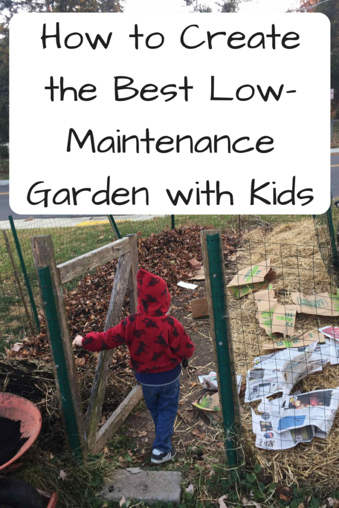 The Best Low-Maintenance Garden with Kids (Photo: Child in a red and black jacket standing at the entrance of a small garden gate with newspapers on the garden.)