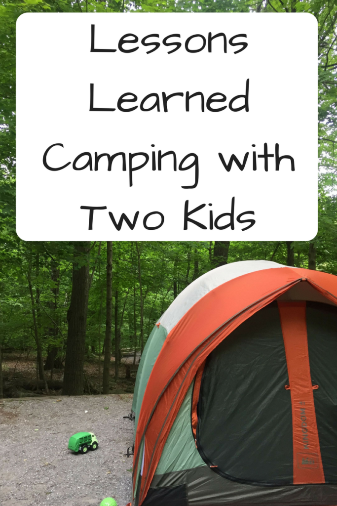 Lessons Learned Camping with Two Kids. Thinking about camping with two kids? Here's what we enjoyed and what we'd do differently next time. (Photo: Orange, white and green tent on a packed dirt campsite in front of trees with a toy truck.)