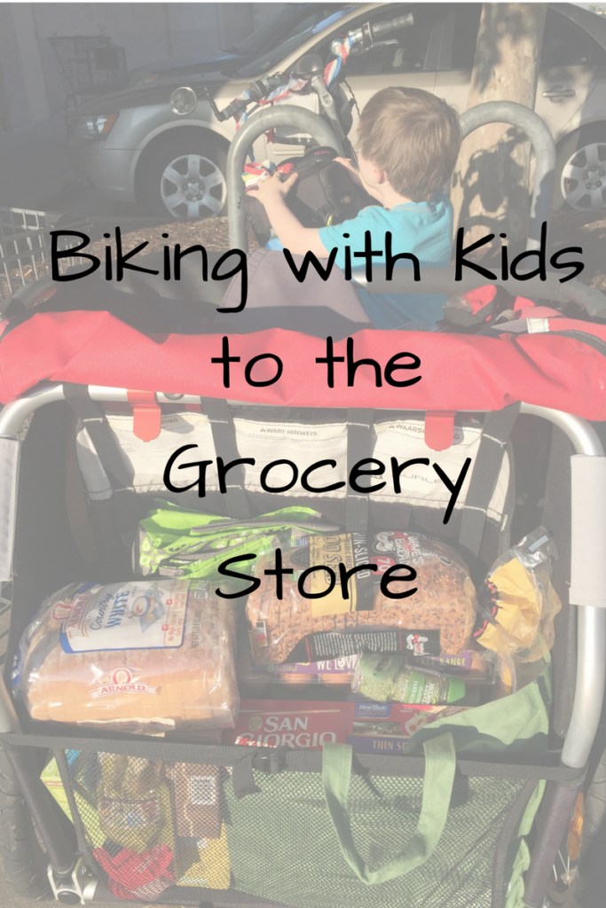 Biking with Kids to the Grocery Store. Ever thought of running errands on your bike with your kids? Here's our experience! (Photo: Bike trailer filled with groceries)