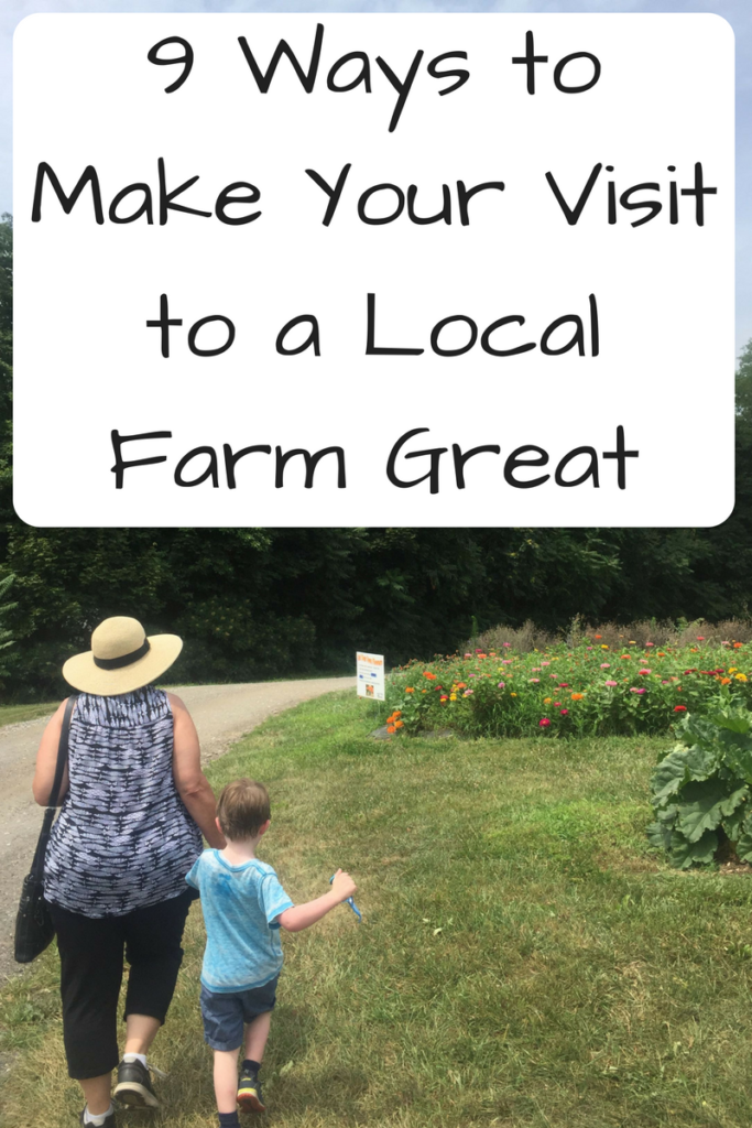 9 Ways to Make Your Visit to a Local Farm Great. Visiting a local farm with kids? Be sure to prepare beforehand! (Photo: Woman and child from the back walking along a dirt road next to flowers.)