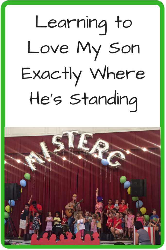 "Learning to Love My Son Exactly Where He's Standing. What happens when your music loving kid doesn't want to go up front to a concert? (Photo: Kids standing on stage with a musician with the words ""Mister G"" in balloon letters above them.)"