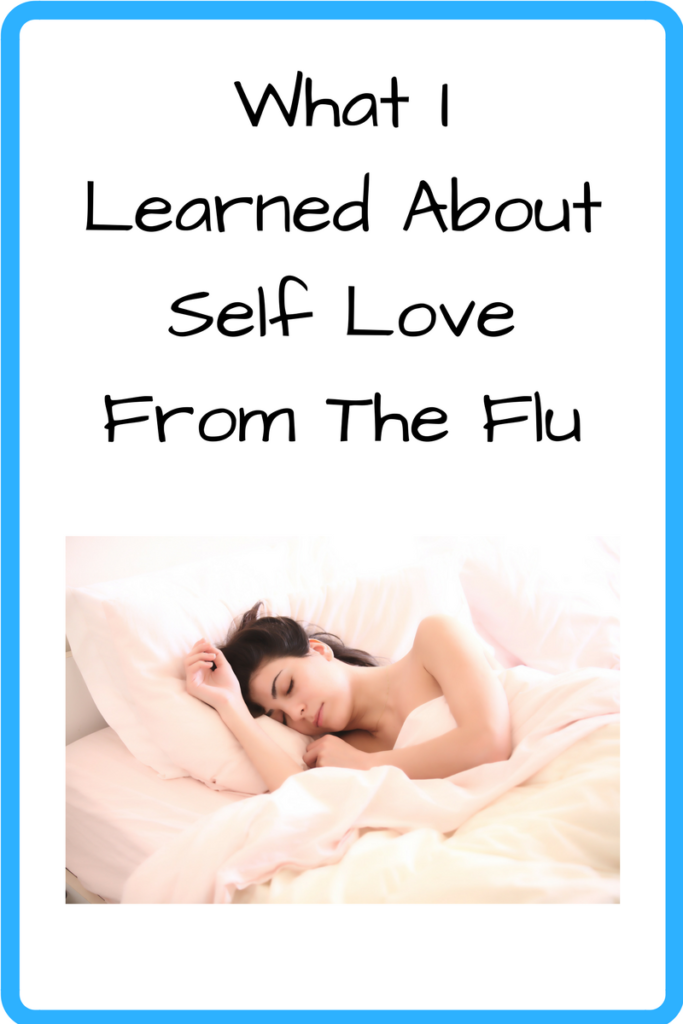 What I Learned About Self-Love from the Flu. (Photo: White woman lying in bed on a pillow, sleeping.)