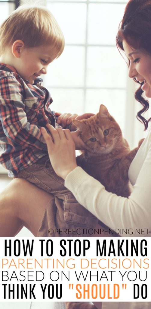 """How to Stop Making Parenting Decisions Based on What You Think You """"Should"""" Do (Photo: White mom with a white young boy on her lap and a cat sitting between them)"""