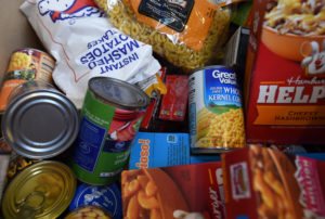 Photograph of a pile of canned and boxed foods