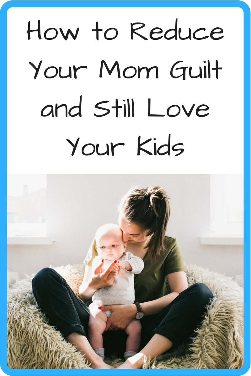 How to Reduce Your Mom Guilt and Still Love Your Kids. (Photo: White woman and baby sitting on a furry beanbag.)