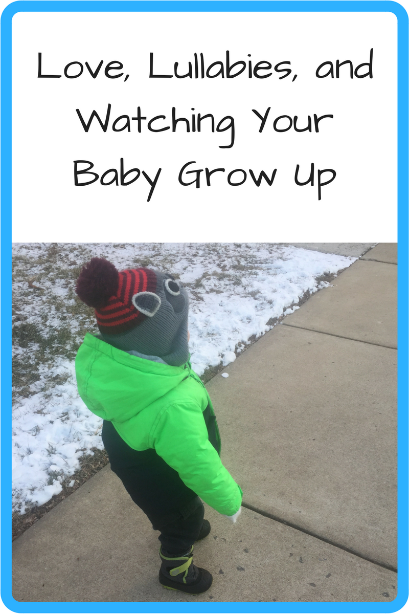 Love, Lullabies, and Watching Your Baby Grow Up (Photo: Small child in a thick jacket and hat walking on a sidewalk next to snow)