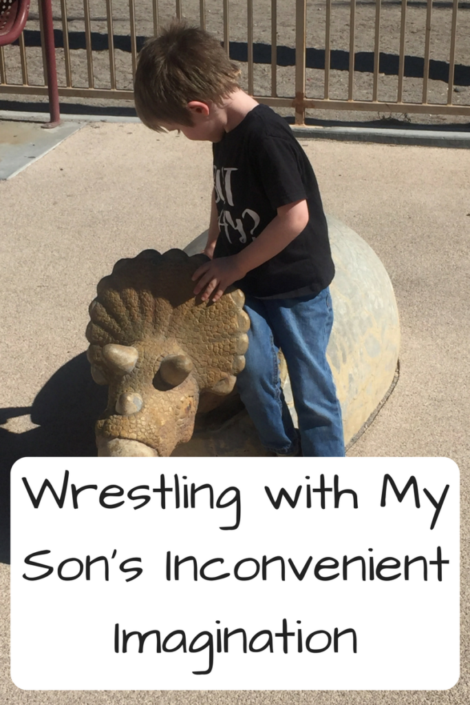Wrestling with My Son's Inconvenient Imagination. (Photo: Young white boy leaning against a statue of a dinosaur hatching from an egg)